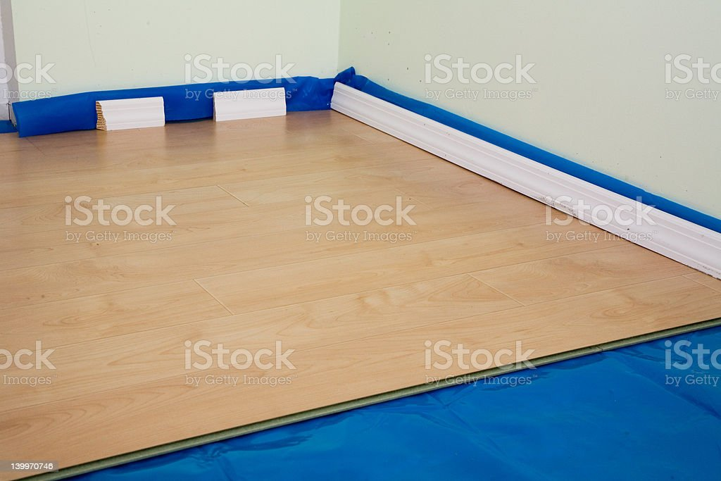 DIY project: half finished laminate floor royalty-free stock photo