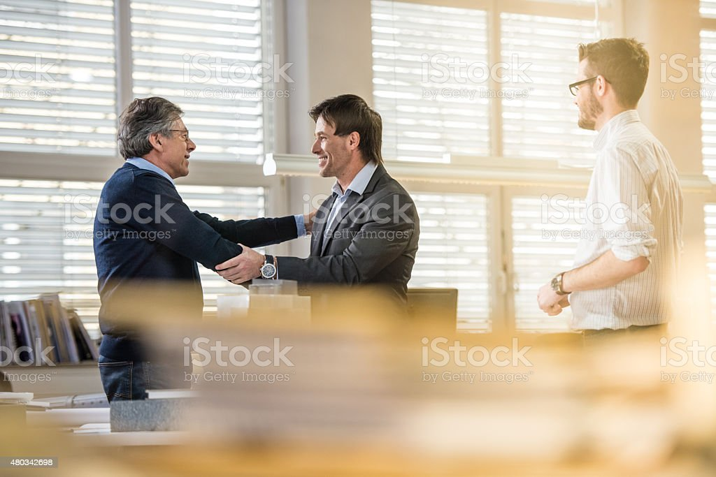 Project manger shaking hand with client stock photo