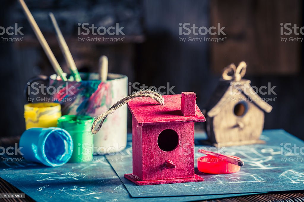 Project of home for birds in wooden workshop stock photo