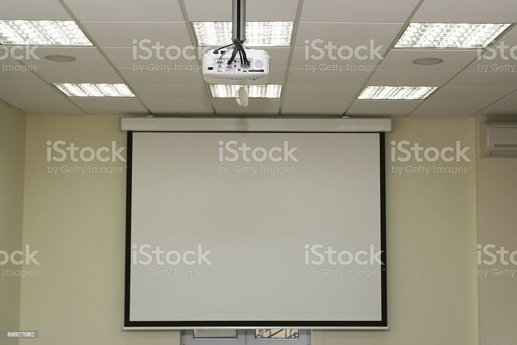 Projection screen in the boardroom with projector stock photo
