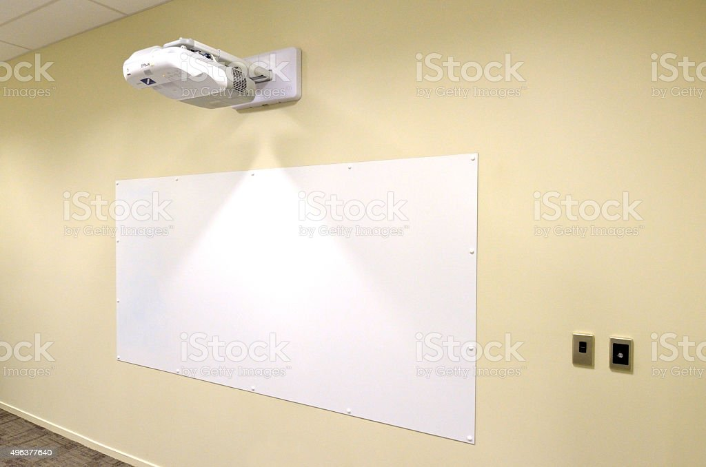 Projection screen with video image projector stock photo