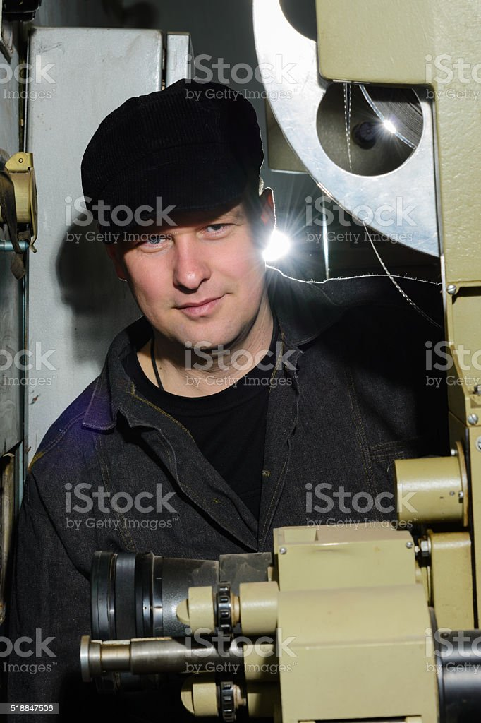 projectionist at work in the room stock photo