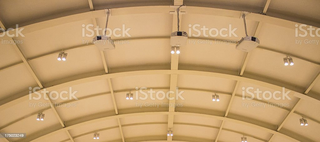 Projector hang on ceiling in meeting room royalty-free stock photo