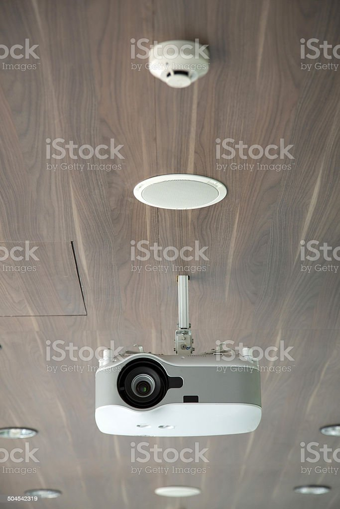 Projector hang on wooden ceiling royalty-free stock photo