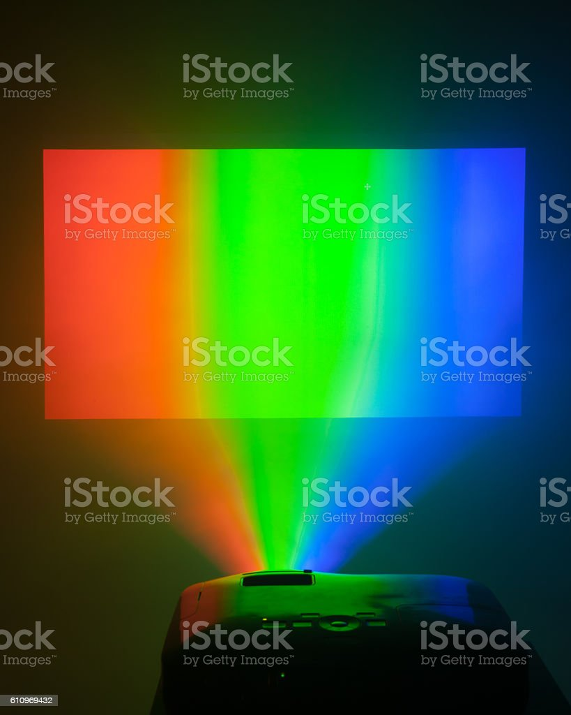 projector in action with illuminated rgb screen stock photo