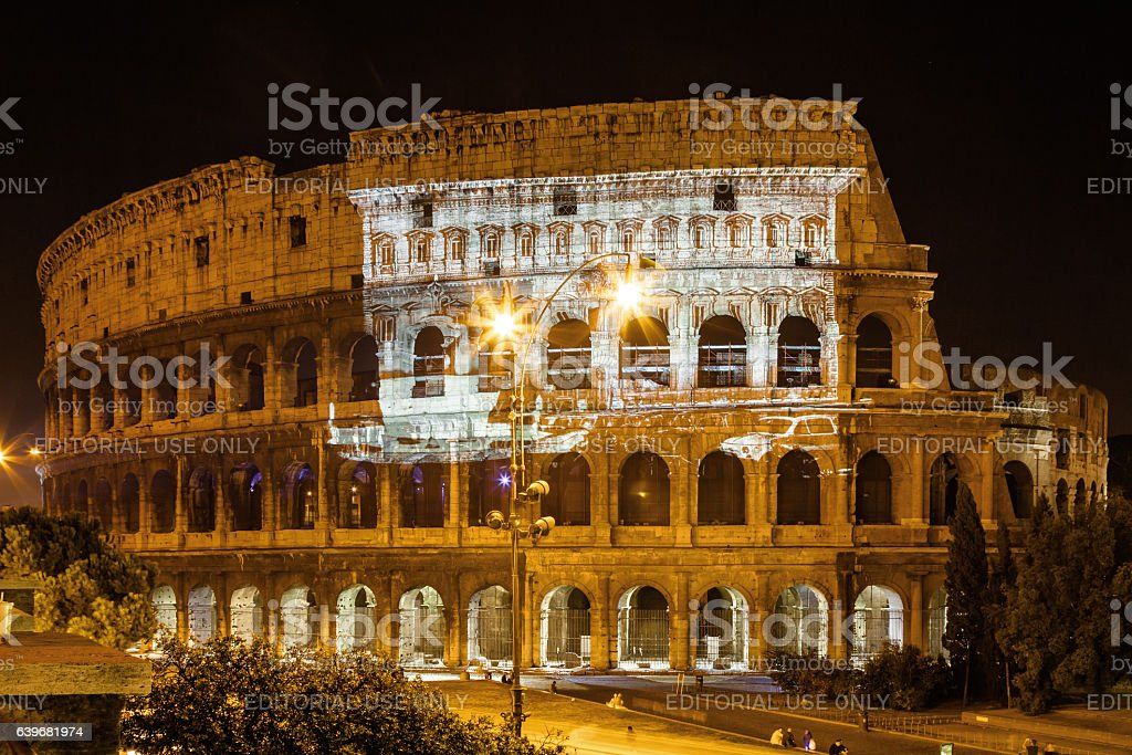 Projector lights olympic pictures on Colosseo. stock photo