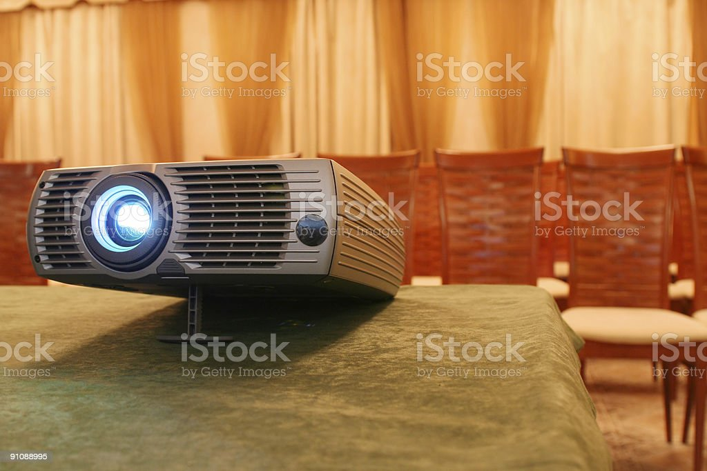 Projector on table with chairs behind (horizontal) royalty-free stock photo