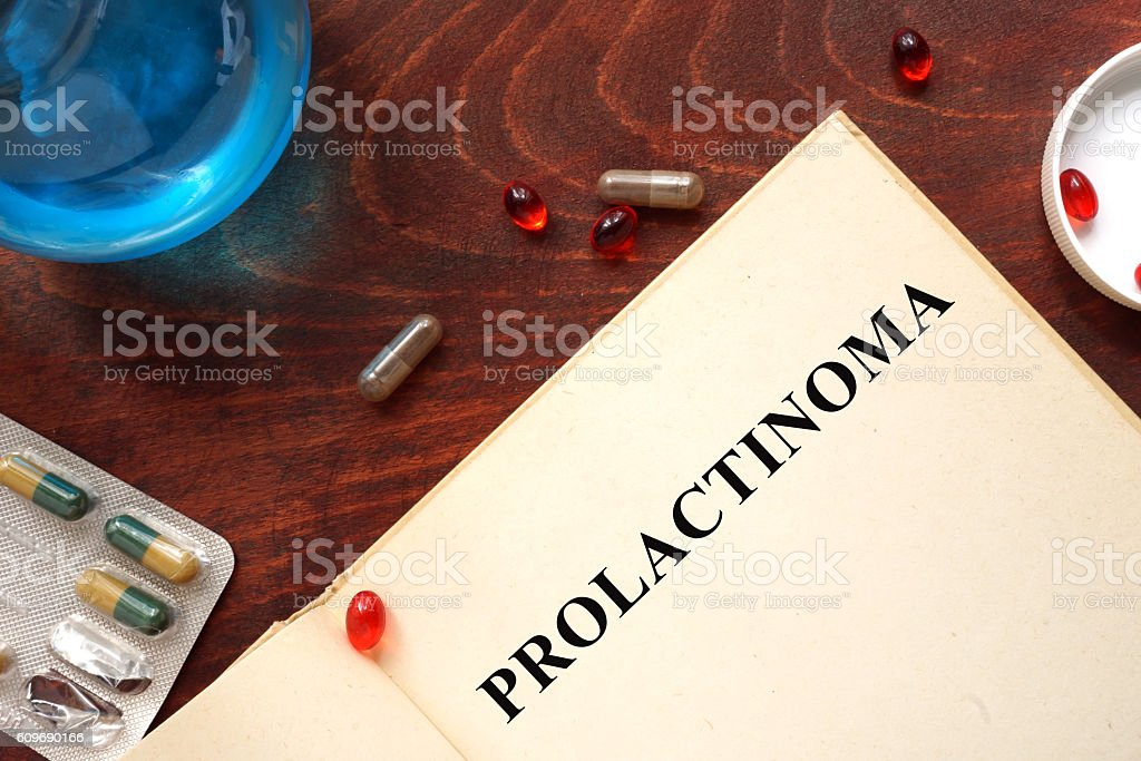 Prolactinoma  written on book with tablets. stock photo