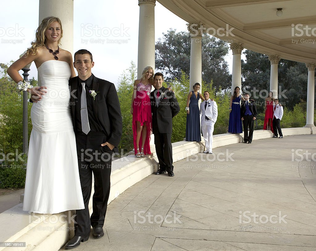 Prom Couples Posing Along Columns royalty-free stock photo