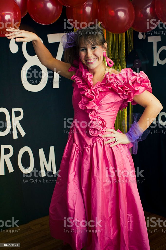 A prom queen in a bright pink dress stock photo