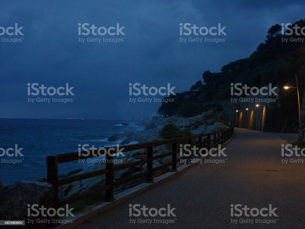 Promenade close to the cliff with a seastorm stock photo