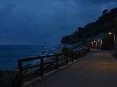 Promenade close to the cliff with a seastorm