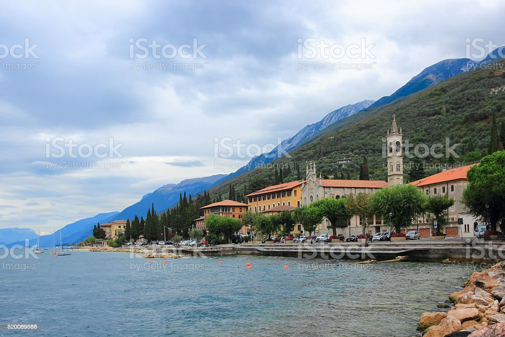 Promenade of town Castelletto with a chapel, cathedral and mountains stock photo