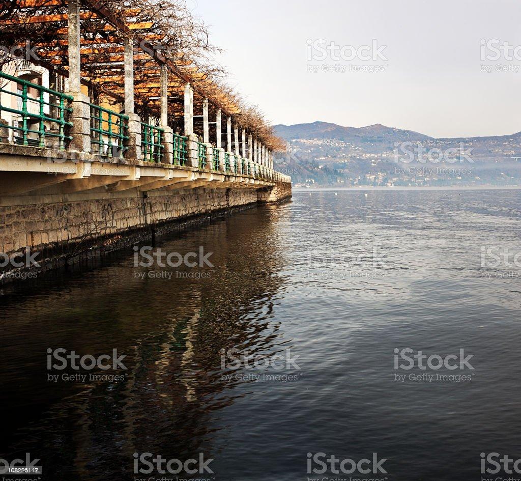 Promenade on Lake Maggiore with Hill in Background stock photo