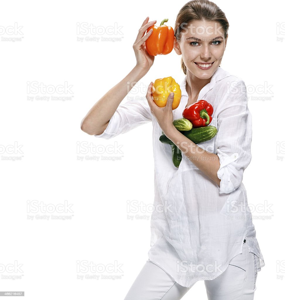 promo girl holds red and orange paprikas - isolated royalty-free stock photo