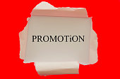 Promotion word written under torn paper