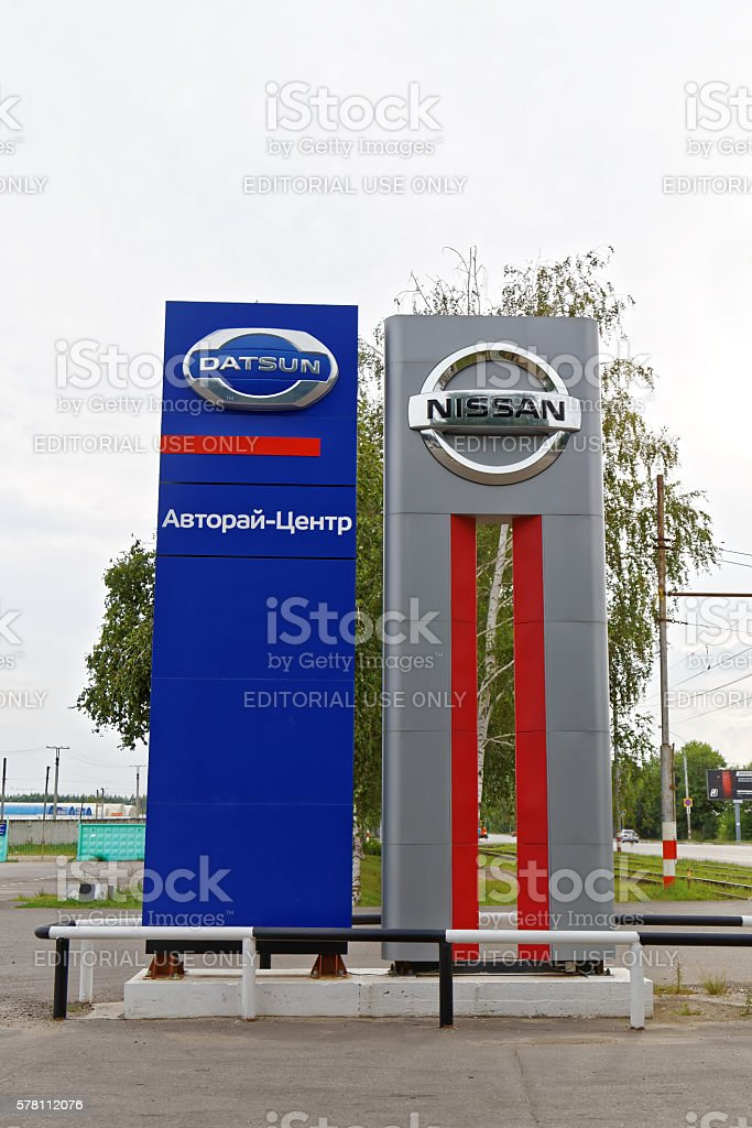Promotional stand with Nissan and Datsun signs near selling and stock photo