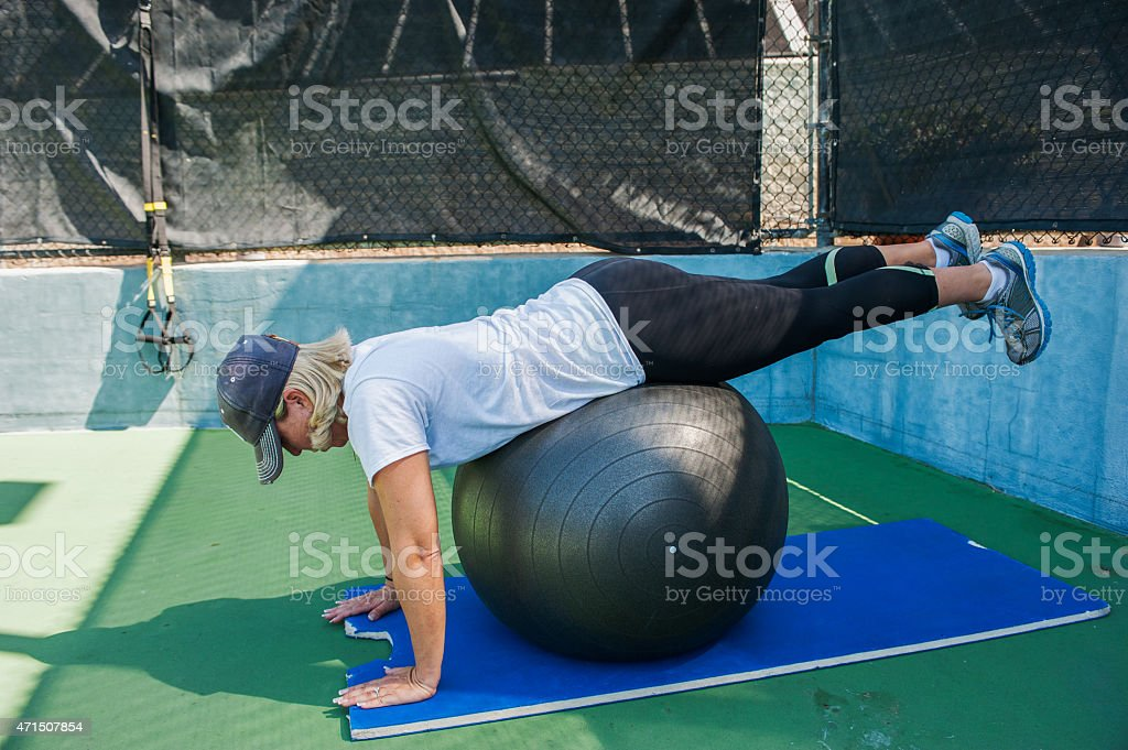Prone hip extension exercise stock photo