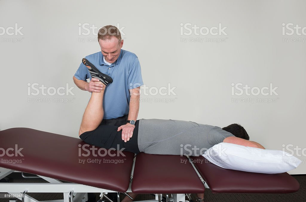 Prone Hip Flexor Stretch in Physical Therapy stock photo
