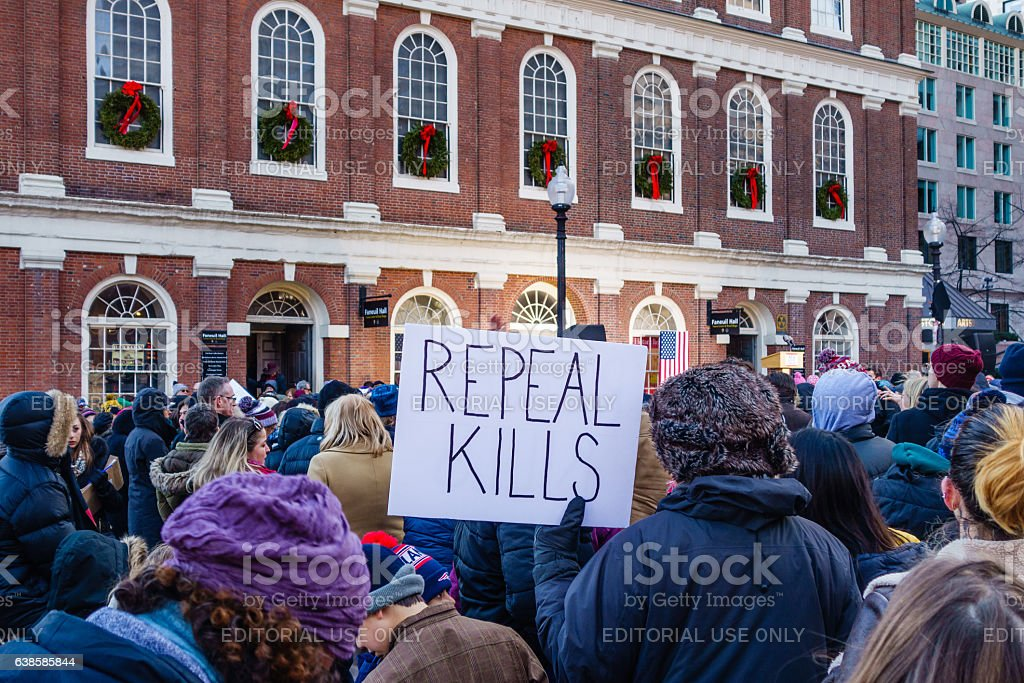 Pro-Obamacare protester with sign reading 'Repeal Kills' stock photo