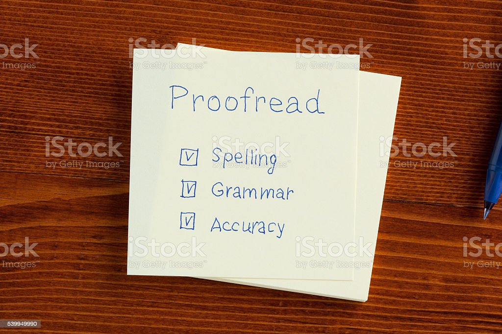 Proofread written on a note stock photo