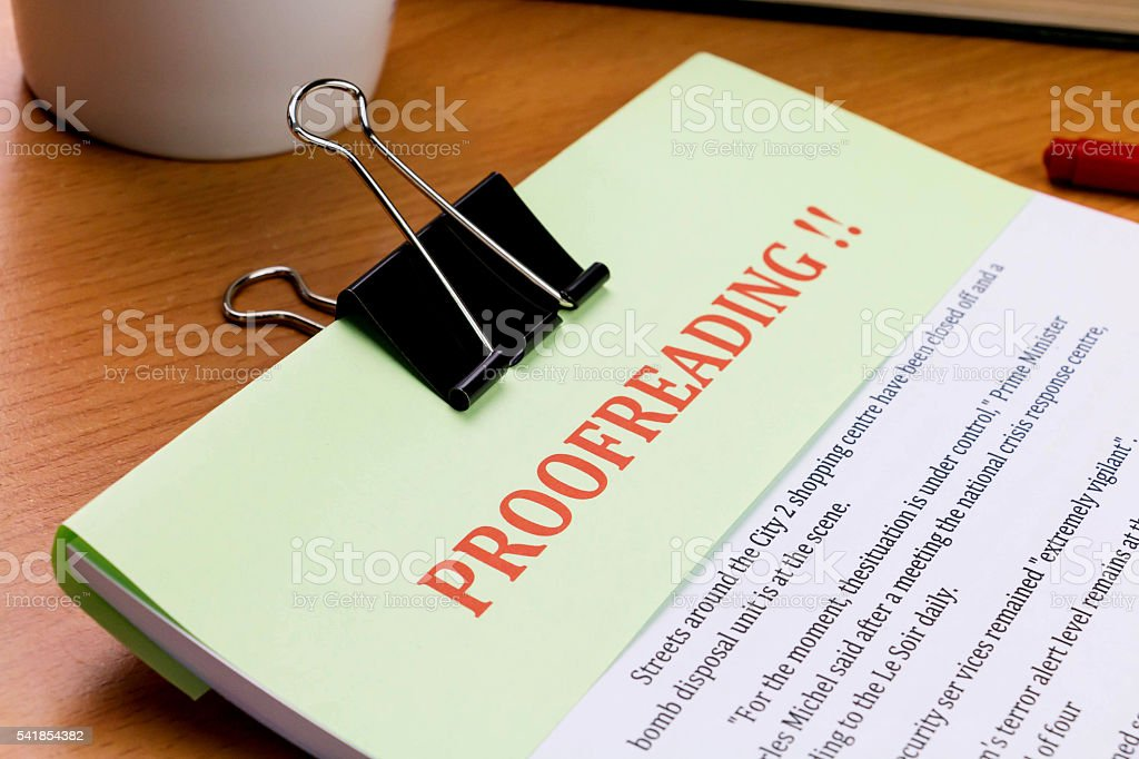 proofreading red word on green sheet stock photo