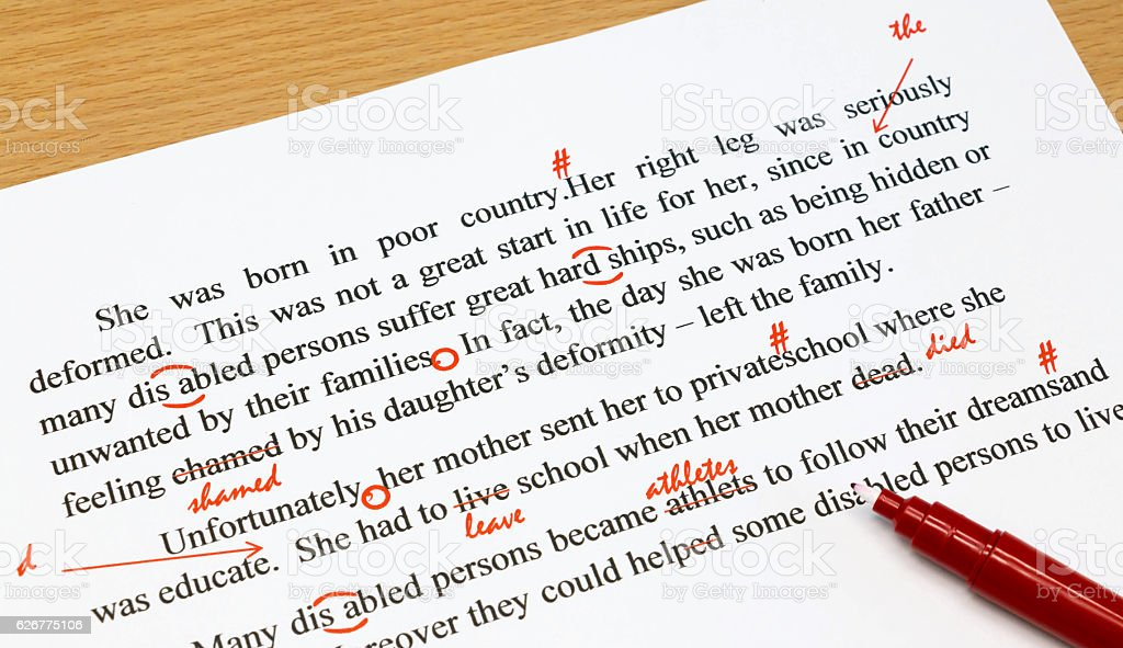 proofreading sheet on table stock photo