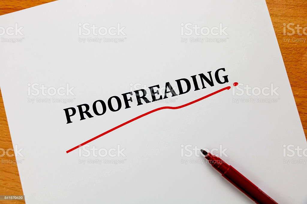 proofreading word on white sheet with red pen stock photo