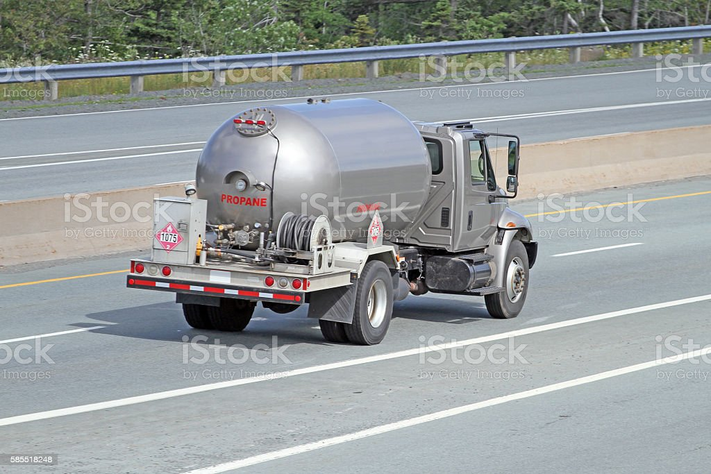 Propane Delivery Truck Travelling Interstate Highway, Rear Quarter View stock photo
