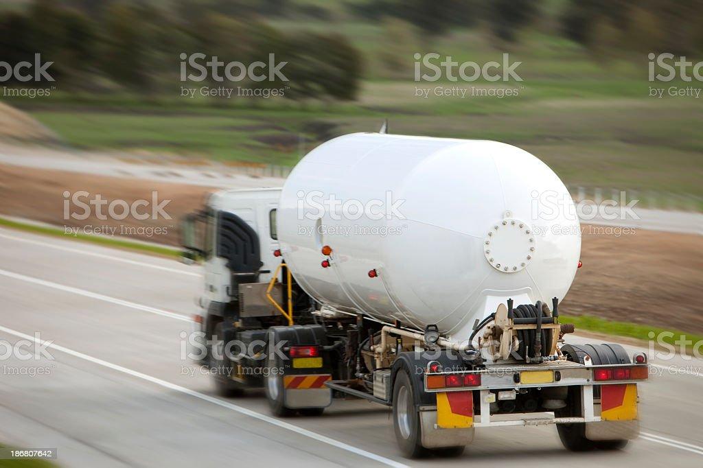 LPG / propane truck on freeway speeding by stock photo