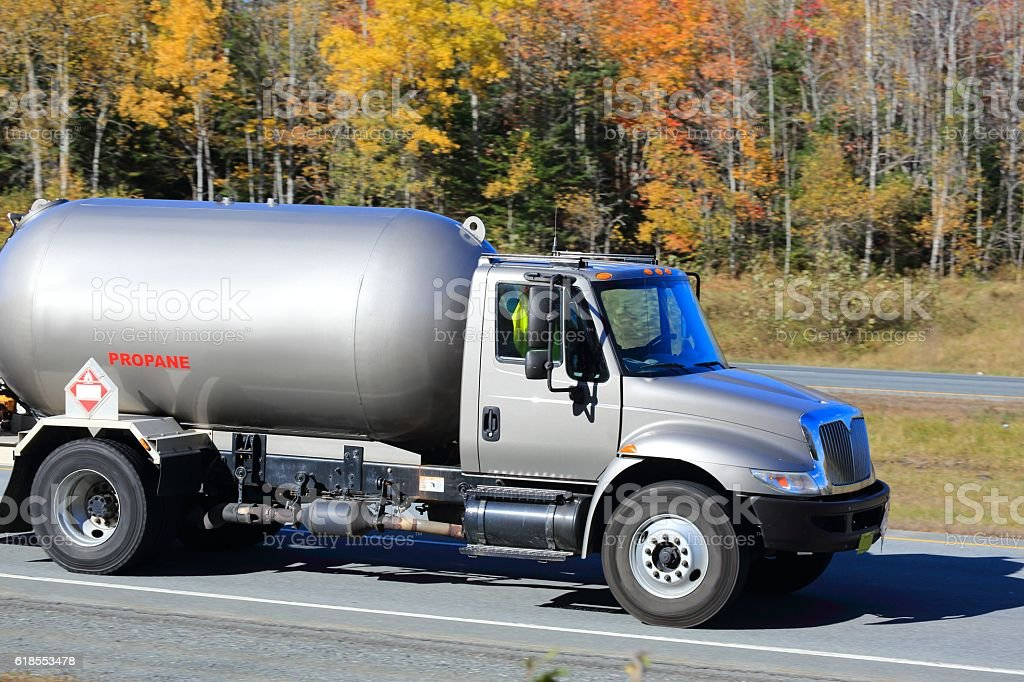 Propane truck, trees in background stock photo