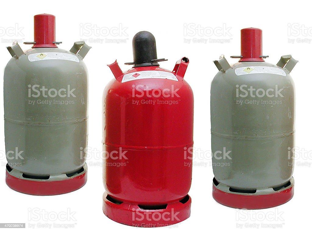Propangasflaschen (graue Eigentumflasche, rote Mietflasche) stock photo
