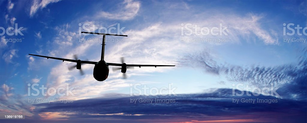 propeller airplane flying at twilight royalty-free stock photo