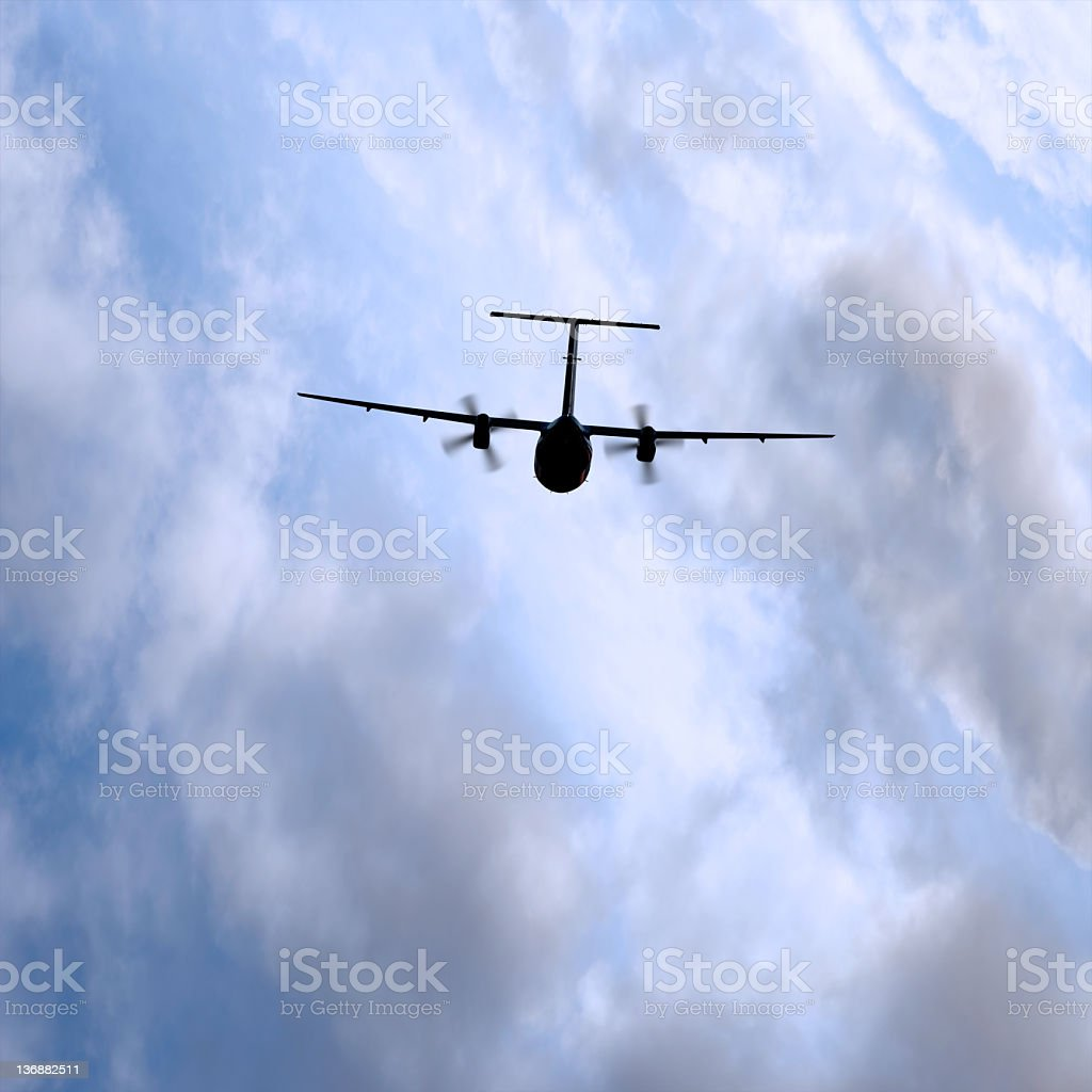 XL propeller airplane flying in storm stock photo