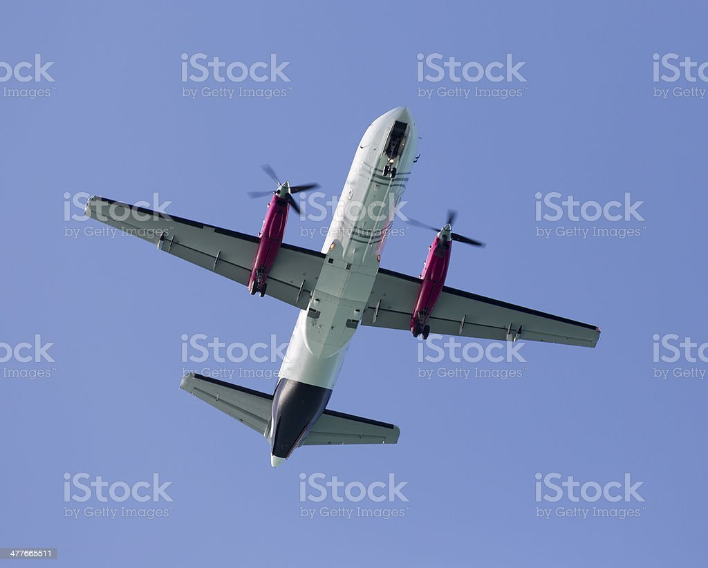 Propeller airplane from below royalty-free stock photo