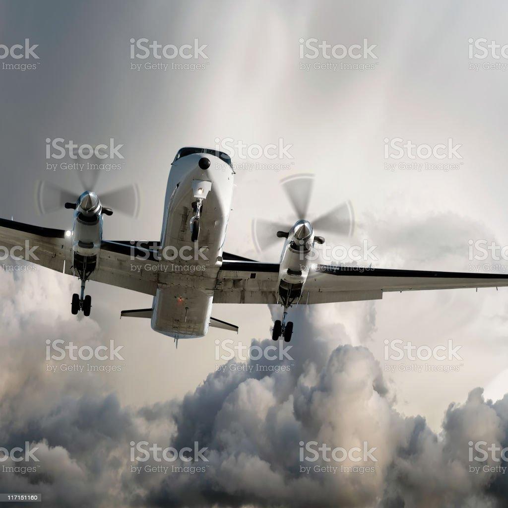 propeller airplane landing in storm stock photo