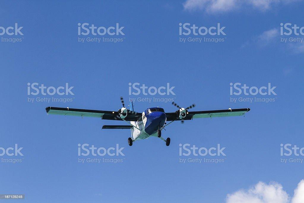 Propeller Airplane Landing royalty-free stock photo