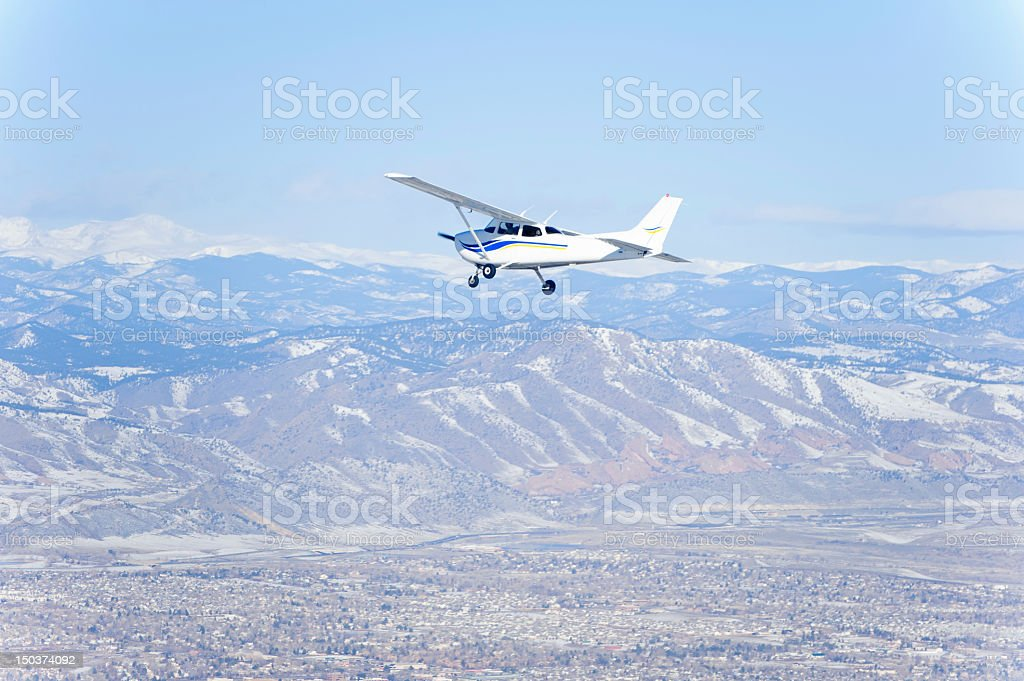 Propeller Airplane with Mountains stock photo
