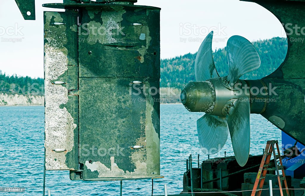 Propeller and rudder of ship in dry dock stock photo