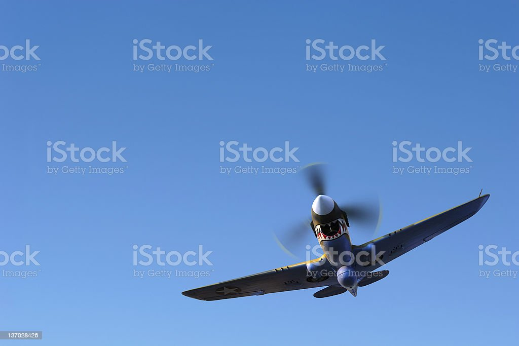 propeller fighter airplane flying in clear sky royalty-free stock photo