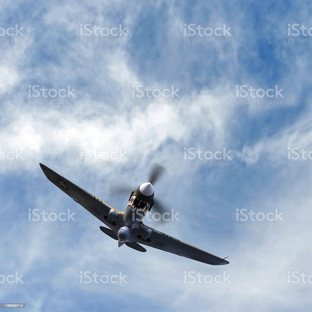 propeller fighter airplane flying in cloudy sky royalty-free stock photo