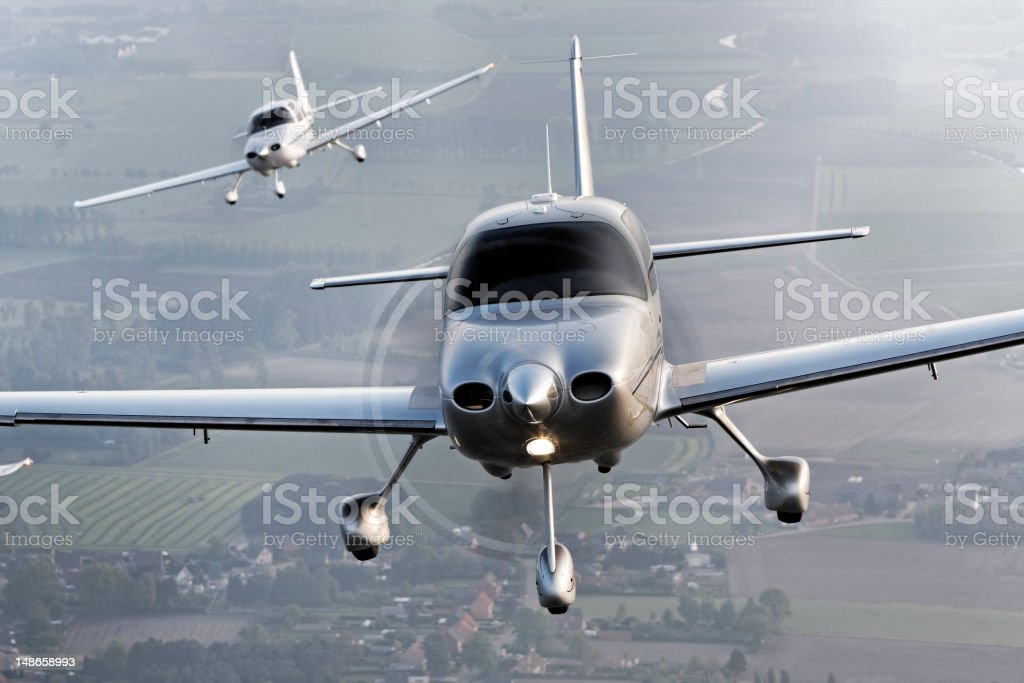propeller modern airplanes flying in formation stock photo