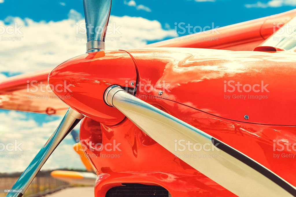 Propeller of a red airplane at the airport stock photo