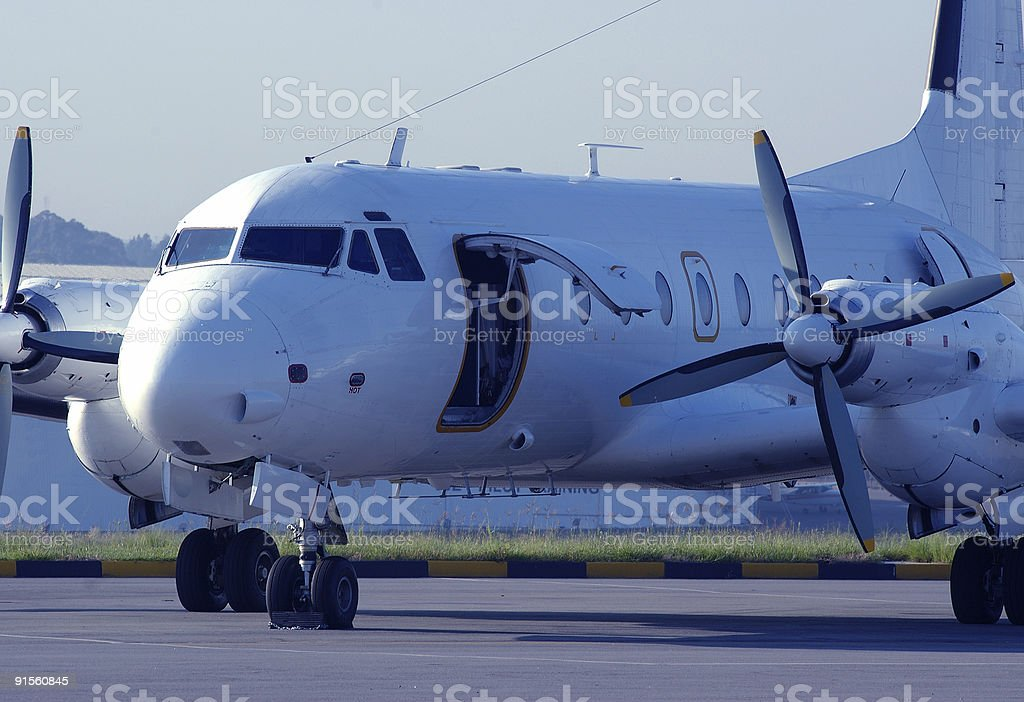 Propeller passenger airplane on runway royalty-free stock photo