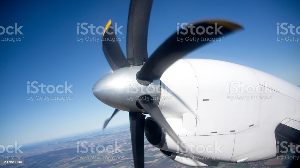 propellor of commercial passenger aircraft in flight stock photo