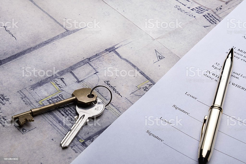 Property and Mortgage deeds sit on top of plans royalty-free stock photo