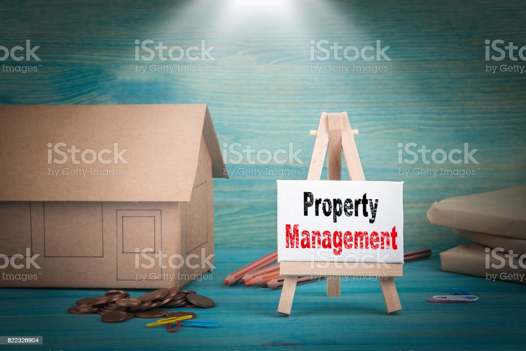 Property Management. home model, money and a notice board under the...