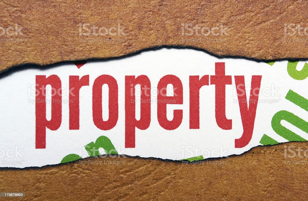 Property text on torn paper royalty-free stock photo