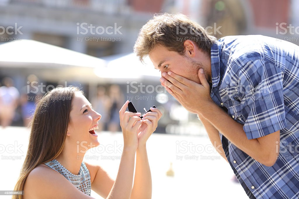 Proposal of a woman asking marry to a man stock photo
