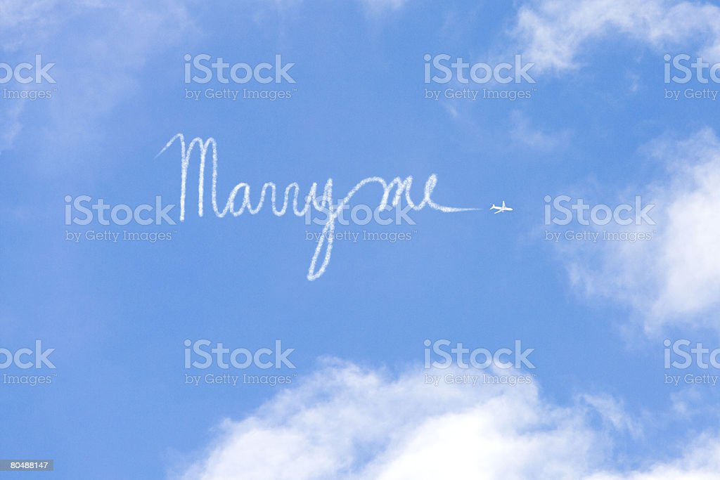 Proposal written in vapour trail stock photo